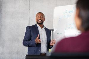 Mature african businessman training employees